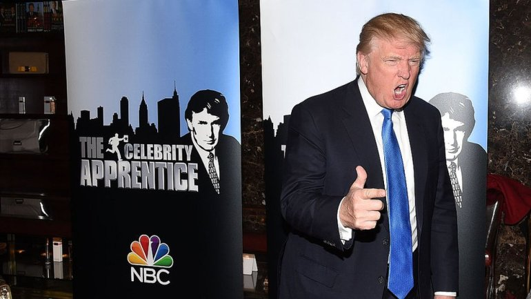 President Donald Trump posing at a red carpet event for the launch of The Celebrity Apprentice TV series in 2015