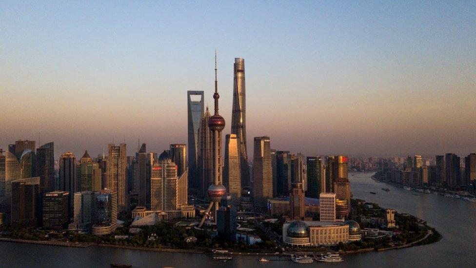 Shanghai skyline at dusk.