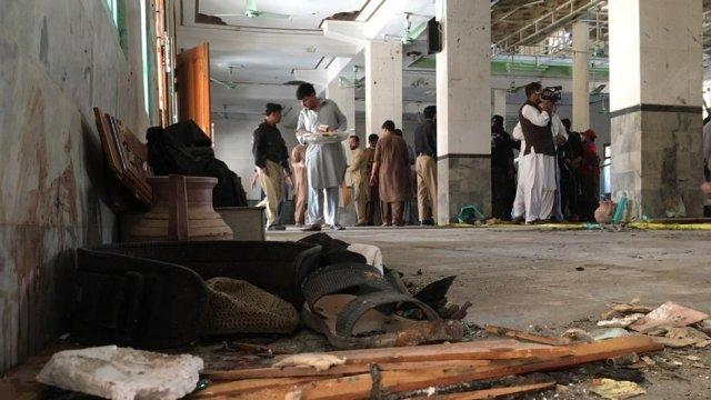 People survey the damage inside the school