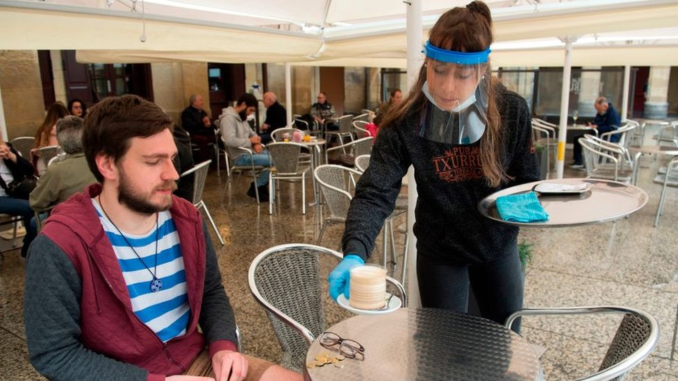 Waitress with face shield