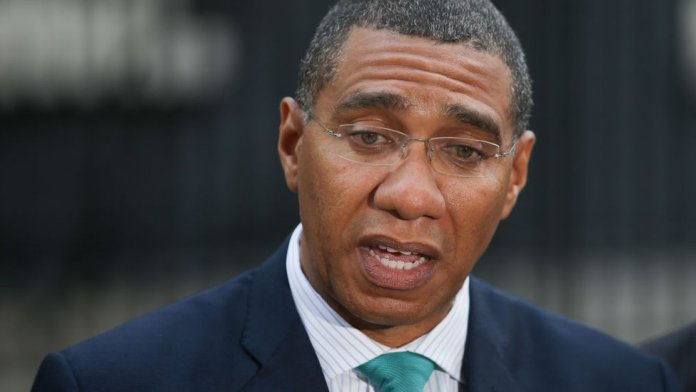 Jamaica's Prime Minister Andrew Holness speaks to the media outside 10 Downing Street in central London, on 17 April 2018