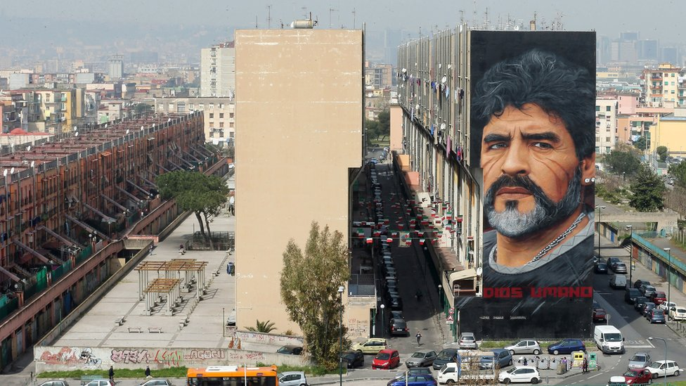 Image shows a Diego Maradona mural in Naples
