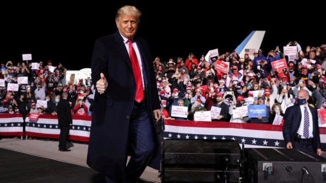 President Donald Trump holds a campaign rally at an airport in Johnstown