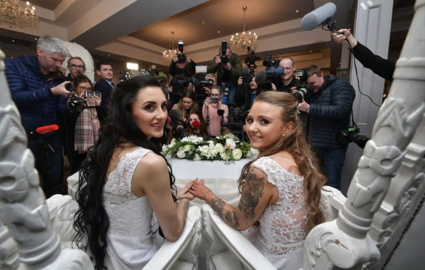 Sharni Edwards (l) and Robyn Peoples, face the media after they became Northern Ireland's first legally married same sex couple on 11 February 2020 in Carrickfergus.