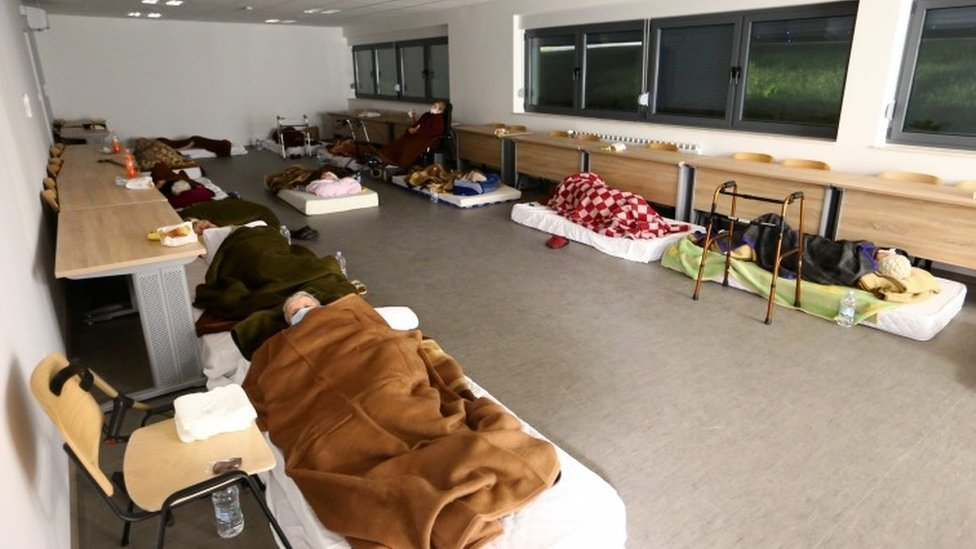 Displaced people sleep at a military base after an earthquake in Petrinja