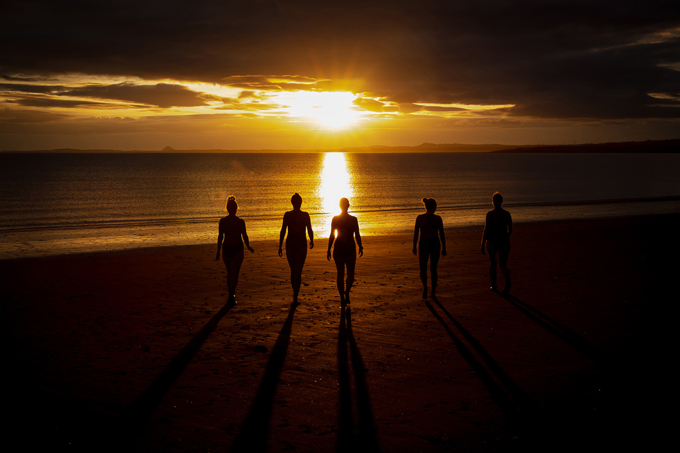 Group of people in silhouette on a beach