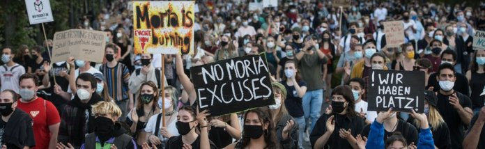 Protesters march in protest for the evacuation of all migrant camps in Greece