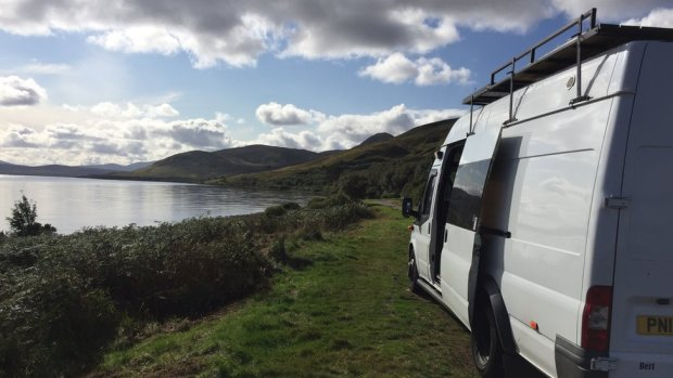 Barny Erdman's van pictured parked next to the coast during a trip around Scotland and Ireland