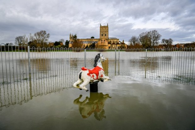 A rocking horse in a park is partially submerged in flood water around Tewkesbury Abbey, Gloucestershire, after storms and heavy rain across the UK. 16 January 2020