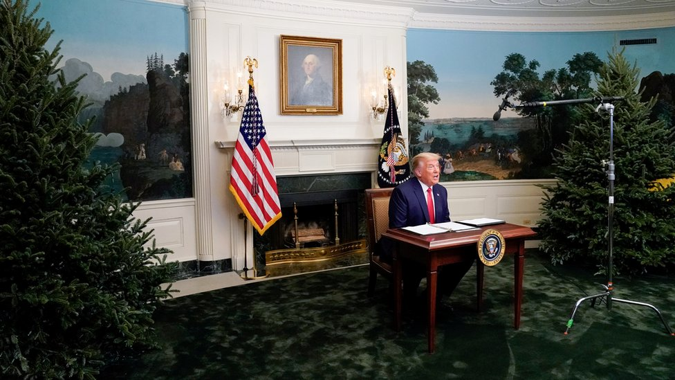 US President Donald Trump participates in a Thanksgiving video teleconference with members of the military forces at the White House in Washington, 26 November 2020