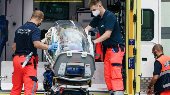 German Army emergency personnel load the portable isolation unit (Epi Shuttle) into their ambulance which was used to transport Russian opposition figure Alexei Navalny to Charite hospital on August 22, 2020 in Berlin, germany