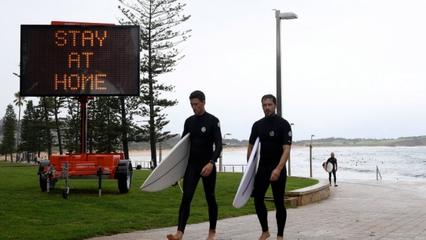 Public health messaging is displayed on temporary signage at Dee Why in Sydney, Australia