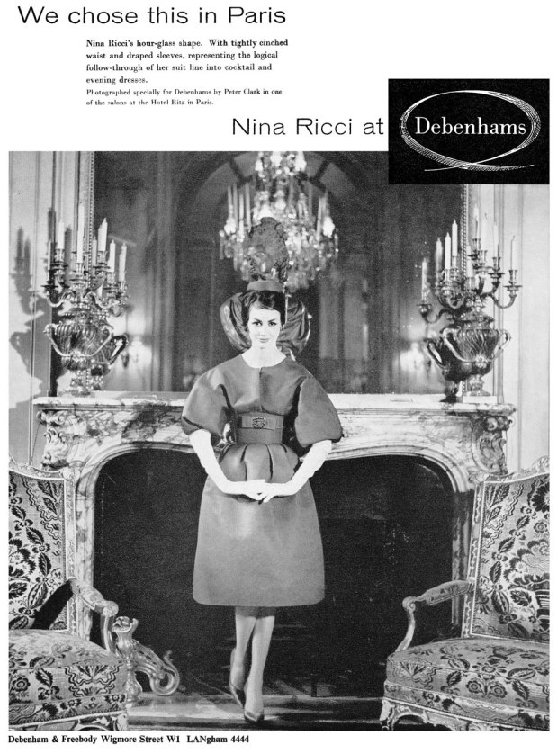 An advert for a fashion brand showing a woman in a dress standing in front of an elegant fireplace