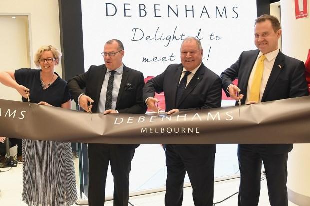 Staff cut a ribbon at an Debenham's store