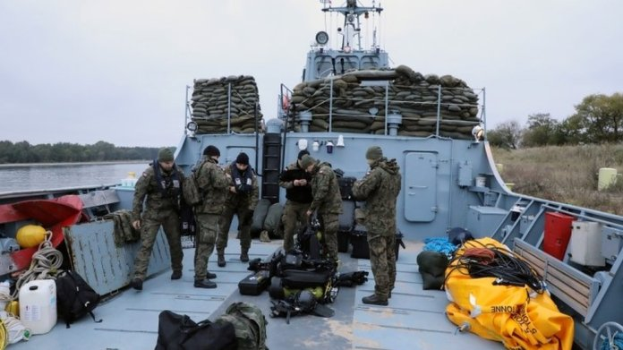 Navy divers from the 12th Minesweeper Squadron of the 8th Coastal Defense Flotilla take part in an operation to defuse the largest unexploded World War Two Tallboy bomb ever found in Poland, in Swinoujscie, Poland