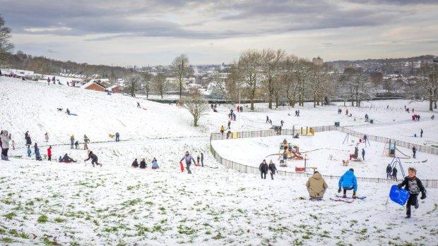 People enjoy the snow in Cheetham Park in Stalybridge on 29 December 2020 in Stalybridge, England