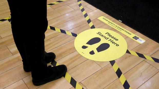 Social distancing signage on a shop floor