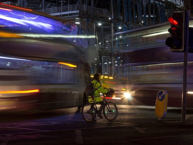 Cyclist in London at night