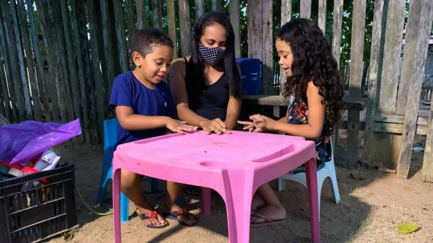 Eugenia Lima Silva plays with her two children