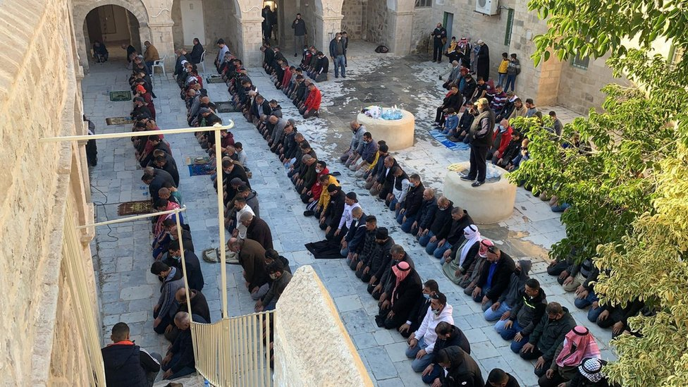 Palestinian Muslims pray at the Nabi Musa site in the West Bank on 27 December 2020