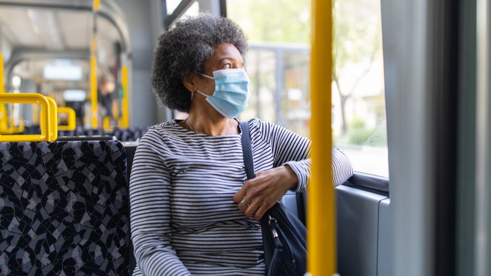 Senior woman on a bus