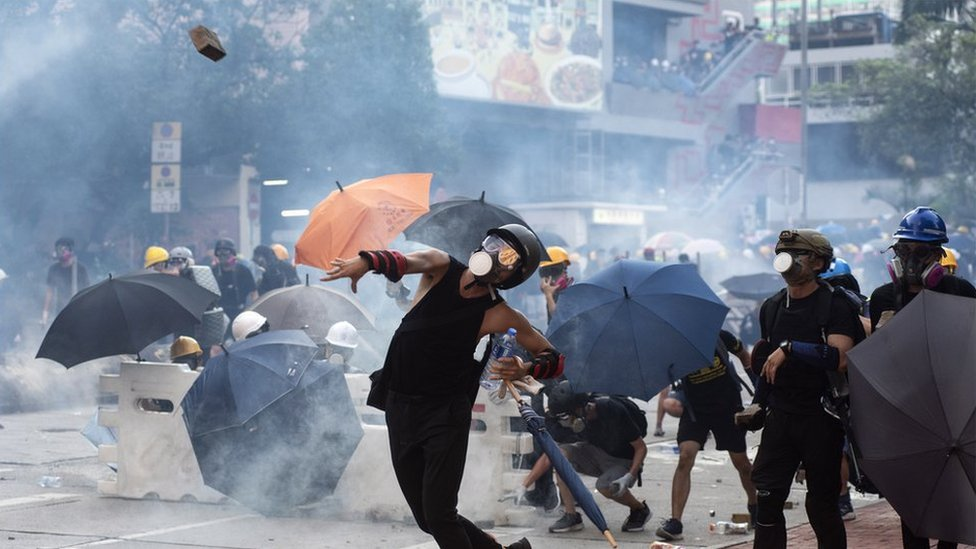Protester throwing brick