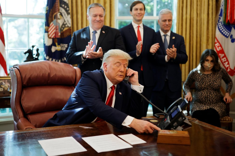 Donald Trump on the phone in the Oval Office