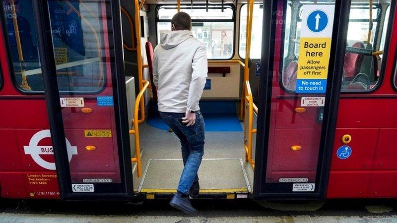 Person boarding bus