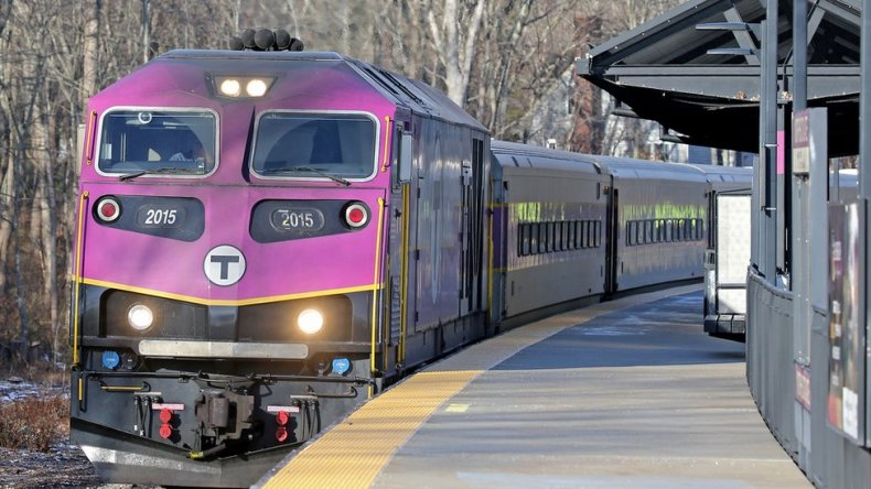 Greenbush line MBTA commuter rail train passes thru North Scituate station after the T announced a reduction in service due to Corvid-19 employee absences on December 11, 2020 in Scituate, MA. (Staff Photo By Stuart Cahill/MediaNews Group/Boston Herald via Getty Images)
