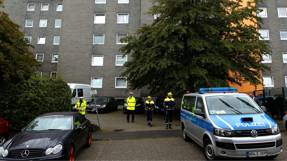 Police officers at a residential building where the bodies of five children were found in the western town of Solingen, Germany, 3 September 2020