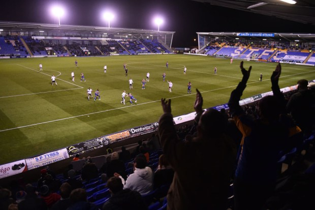 General view inside the stadium as fans show their support from the stands in the match between Shrewsbury Town and Accrington Stanley