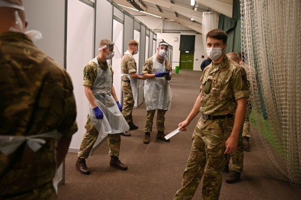 Soliders wear PPE in a testing centre