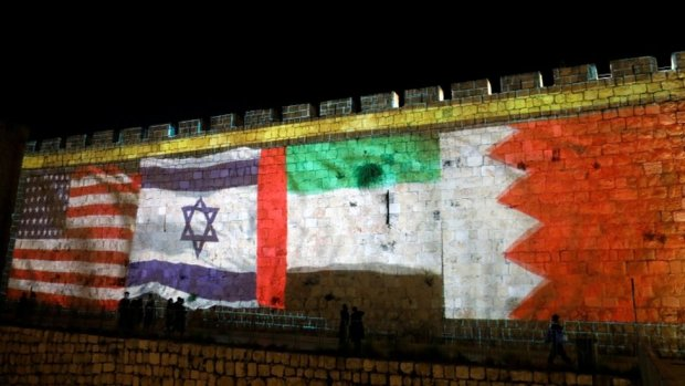 The flags of the United States, Israel, United Arab Emirates and Bahrain are projected on a section of the walls surrounding Jerusalem's Old City