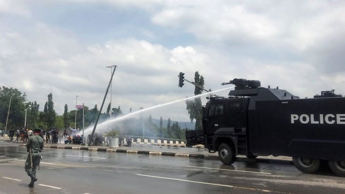 "Police use water cannons to disperse people protesting against alleged brutality by members of Nigeria""s Special Anti-Robbery Squad (SARS), in Abuja, Nigeria October 11, 2020."