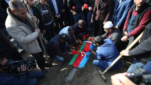 People attend the funeral of seven-year-old Aysu Iskenderova who was killed on 27 October allegedly by Armenian shelling, in the village of Garayusifli near Barda, Azerbaijan, 28 October 2020. Armed clashes erupted on 27 September 2020 in the simmering territorial conflict between Azerbaijan and Armenia over the Nagorno-Karabakh territory along the contact line of the self-proclaimed Nagorno-Karabakh Republic