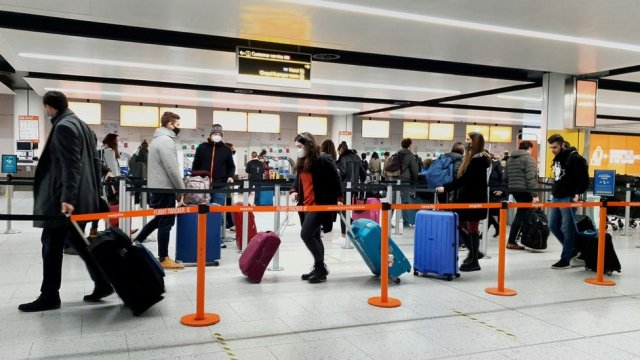 Passengers queue for check-in at Gatwick Airport in West Sussex.