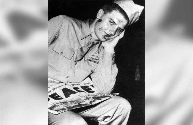 An American soldier is seen with lipstick marks on his face