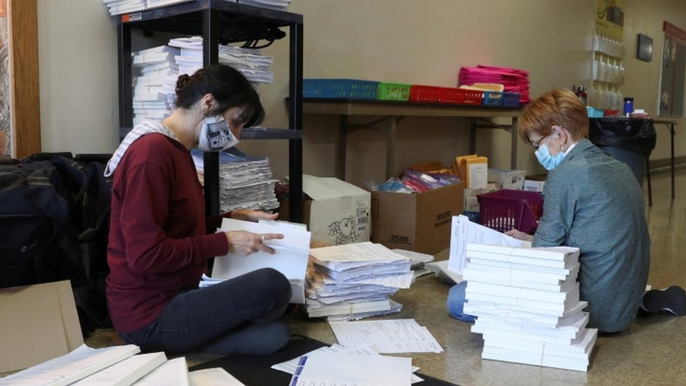 Election officians in Wisconsin sort voter signature books (4 November 2020)