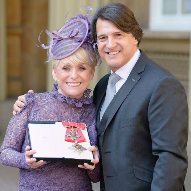 Third husband Scott Mitchell accompanied Windsor when she was made a dame at Buckingham Palace in 2016