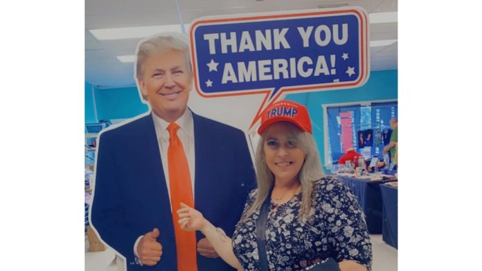Lady with Trump cut-out