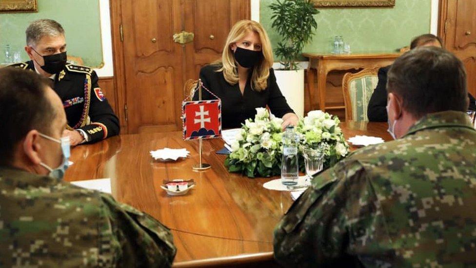 President Caputova (C) with army chiefs