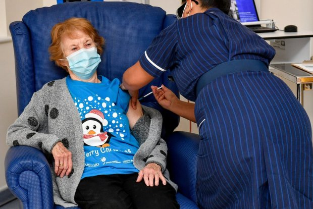 Margaret Keenan, 90, is the first patient in Britain to receive the Pfizer/BioNtech COVID-19 vaccine at University Hospital, administered by nurse May Parsons, at the start of the largest ever immunisation programme in British history, in Coventry, 8 December 2020.