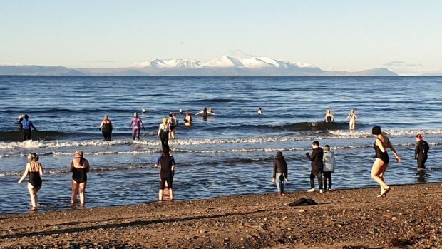 Swimmers head into the sea in Firth of Clyde
