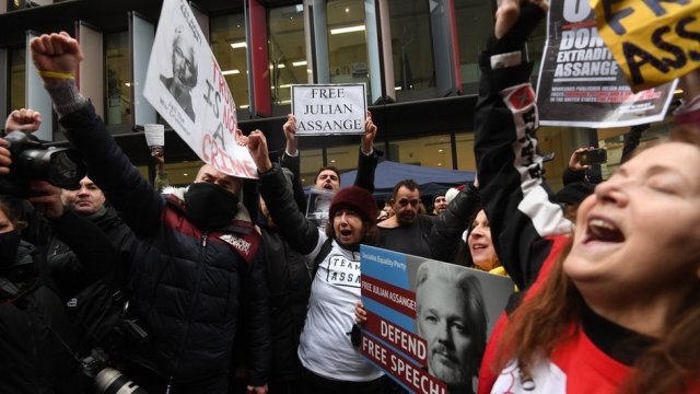 Julian Assange supporters celebrate outside the Old Bailey court in central London, Britain, 04 January 2021. British media report London's Old Bailey courthouse ruled on 04 January 2021