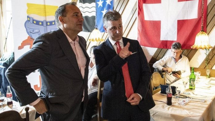 SVP President Marco Chiesa (right) and National Council Member Thomas Matter discuss the limitation initiative in Rothrist, Switzerland