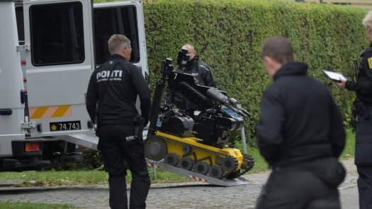 Police officers are seen as Peter Madsen (not pictured) is surrounded by the police in Albertslund, Denmark October 20, 2020