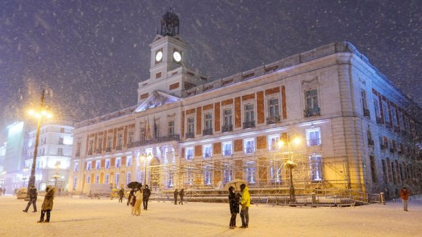 People walk at Puerta del Sol square in Madrid
