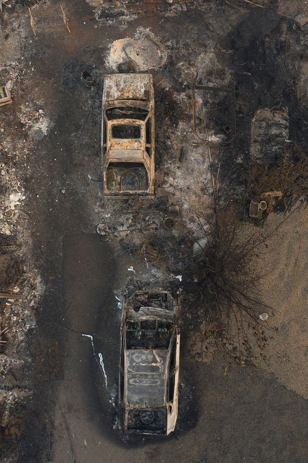 Destroyed cars are seen as the aftermath of the South Obenchain Fire along Butte Falls Highway in Eagle Point, Oregon