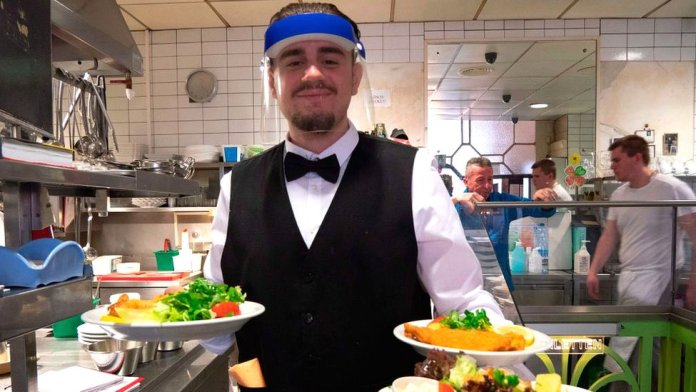 Waiter with face shield