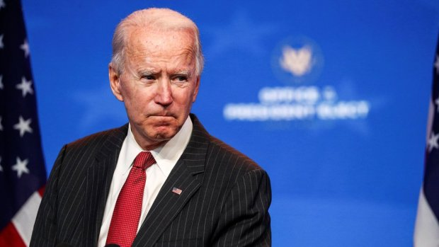 US President-elect Joe Biden speaks to reporters following an online meeting with members of the National Governors Association (NGA) executive committee in Wilmington, Delaware, U.S., November 19, 2020.